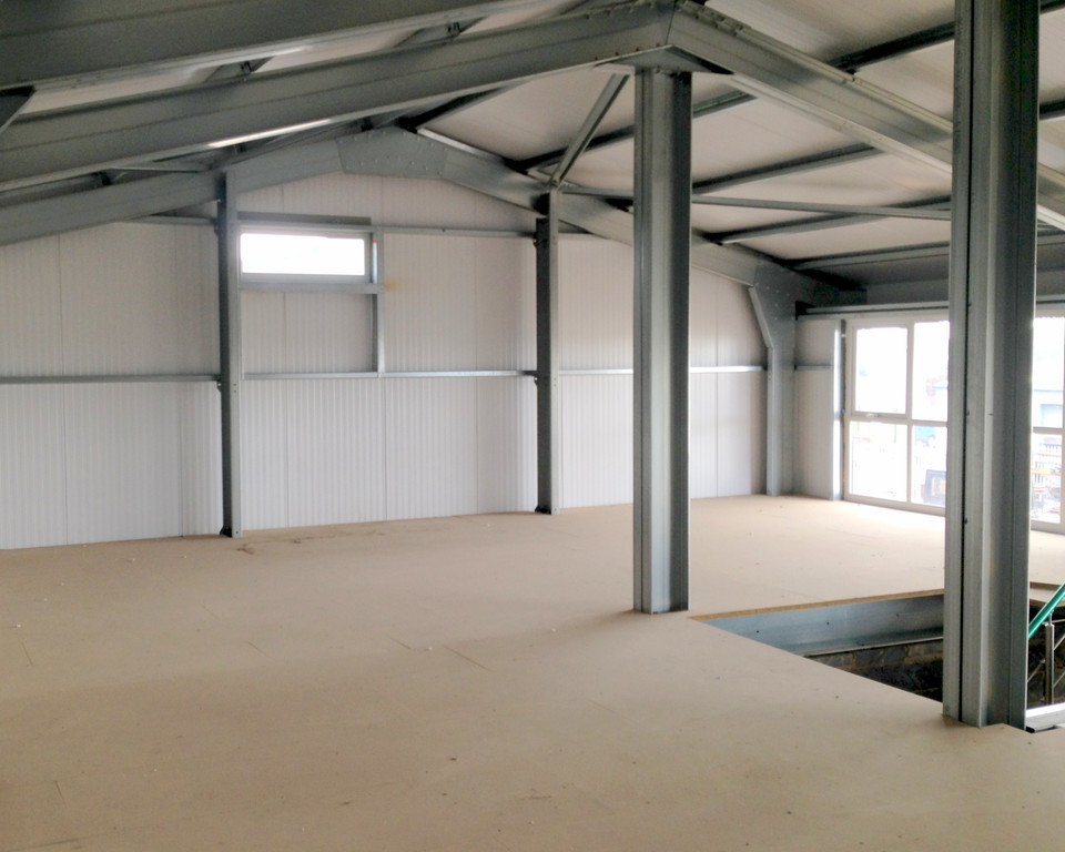 Office Mezzanine Floor under construction supplied and installed by Springfield Steel Buildings