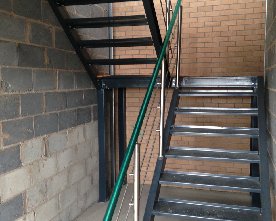 Stairs installed to mezzanine floor prior to office fit out view from ground floor